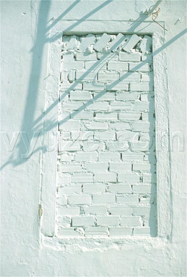 Bricked-up window and shadows / Location: Greece